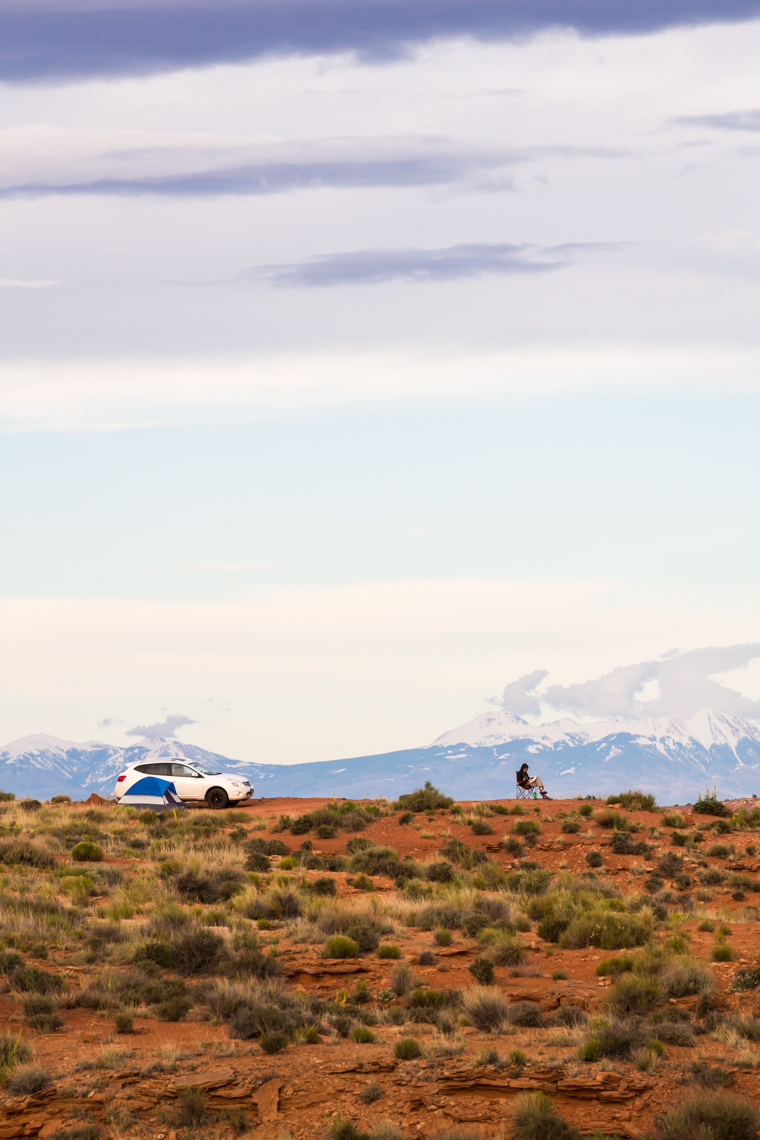 Man car camping with tent in beautiful wilderness landscape, Canyonlands National Park, Utah, United States